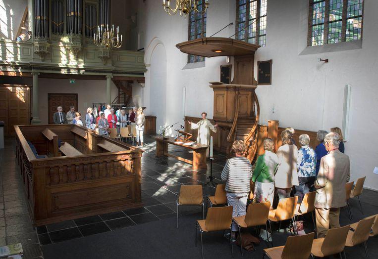 Laatste vieringen in de Waalse Kerk. Bron: Trouw, 12 mei 2018. Fotorgraaf: Werry Crone